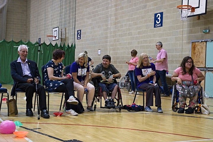 A group of people playing boccia